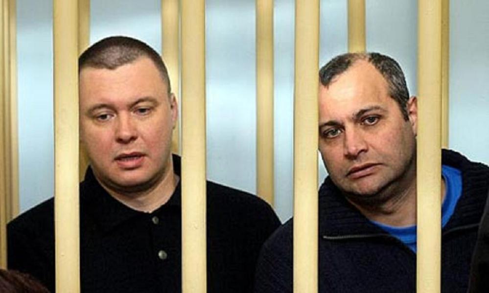 defendants cage russian court