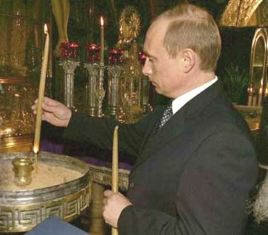 putin-vladimir-lighting-candles.jpg