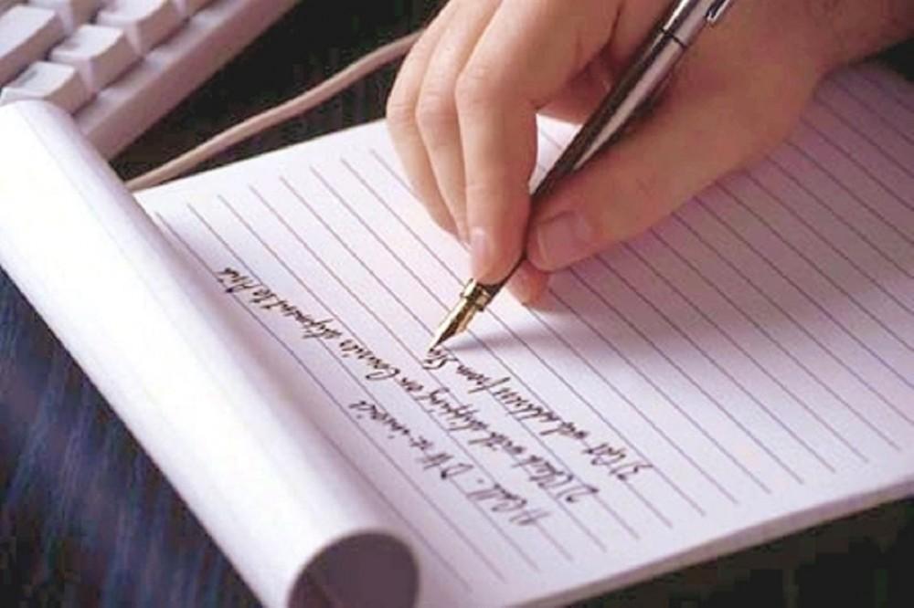 hand writing on a pad