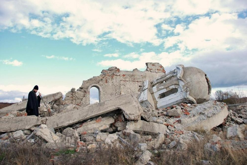 Metropolitan Hilarion of Russia at the remains of a destroyed Serbian Church in Kosovo