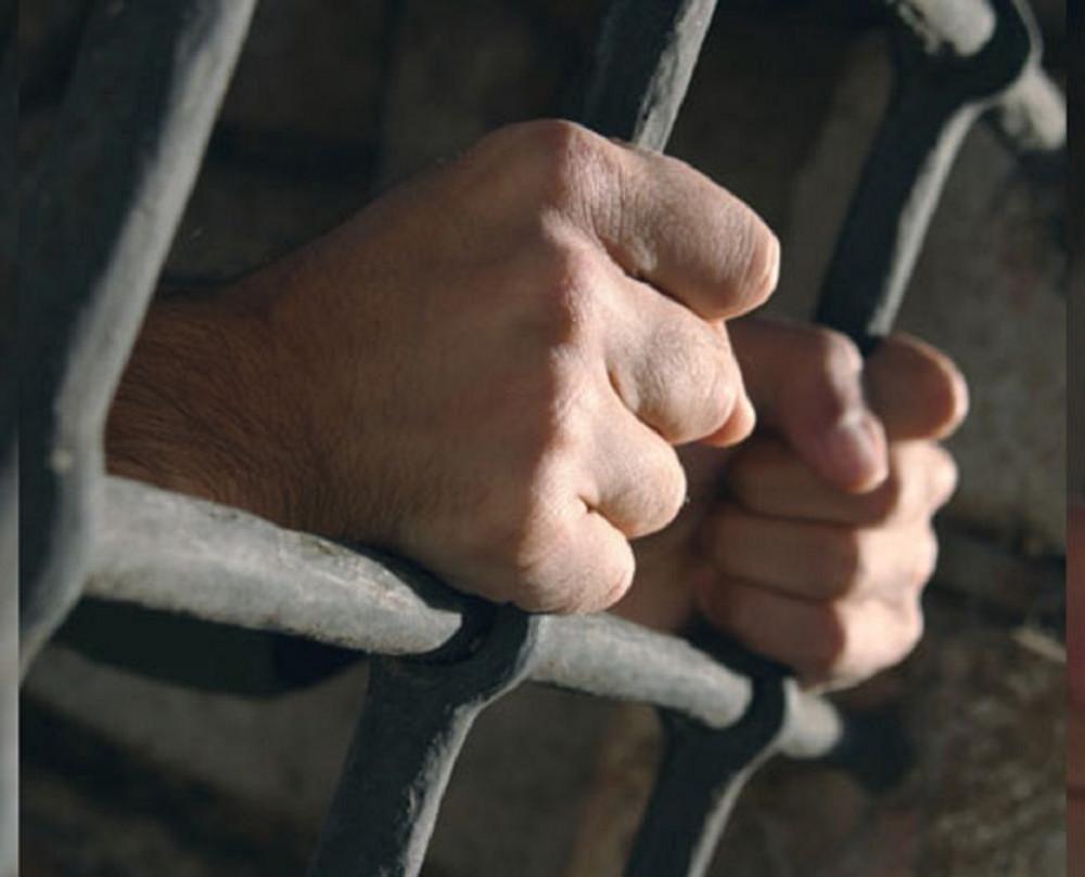 01 behind bars in jail