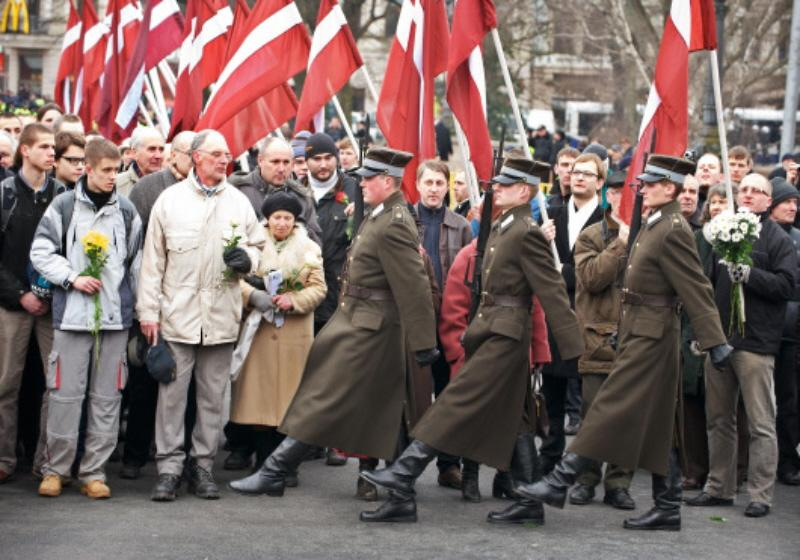 Latvian nazis commemorate Adolf Hitler and Latvian SS men. Former veterans of the Latvian Legion protest in Riga (Ilmars Znotins/AFP/Getty Images)