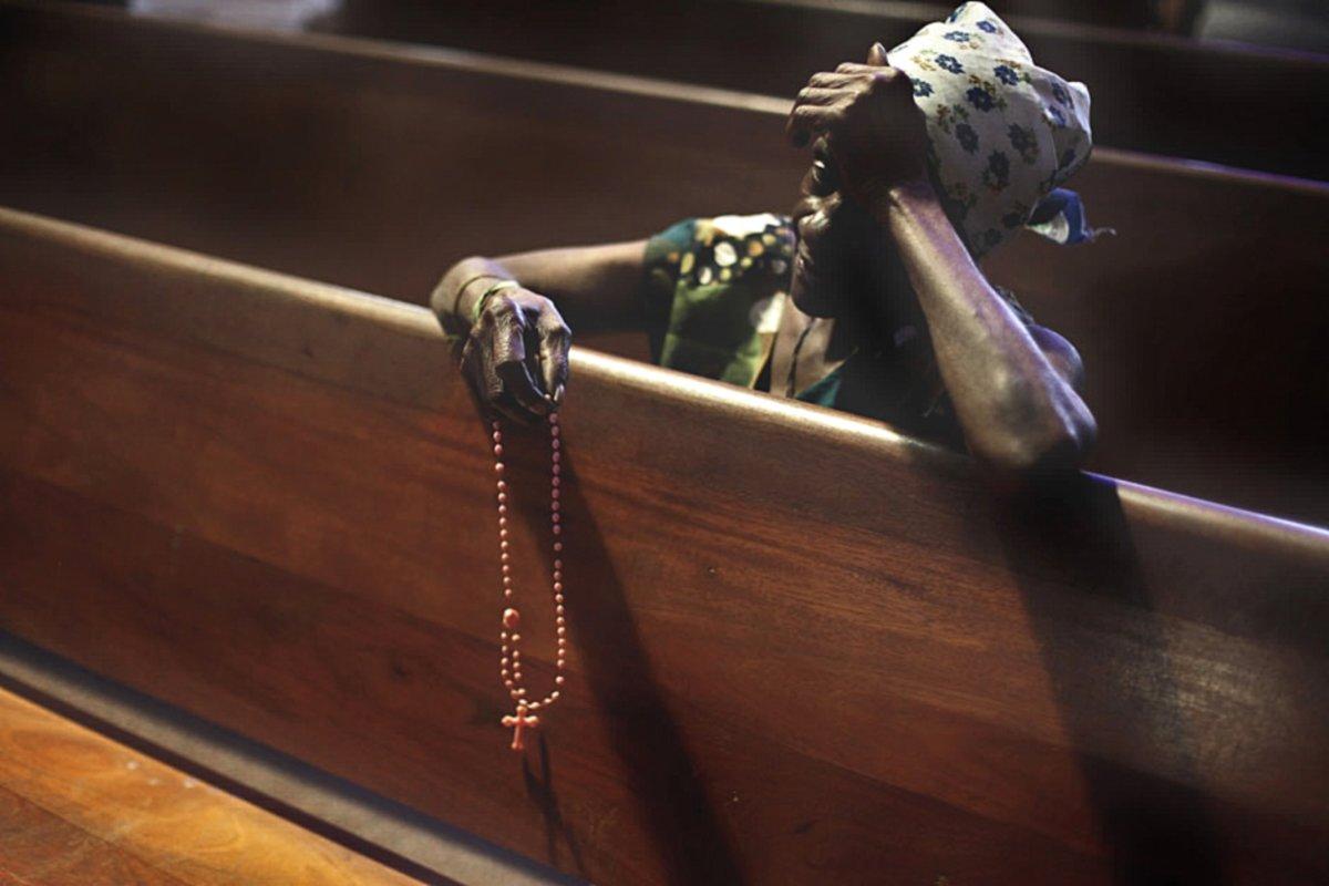 00.1bb A Point of Unity. Catholics woman praying. Basilica of the Virgin Aparecida. BRAZIL