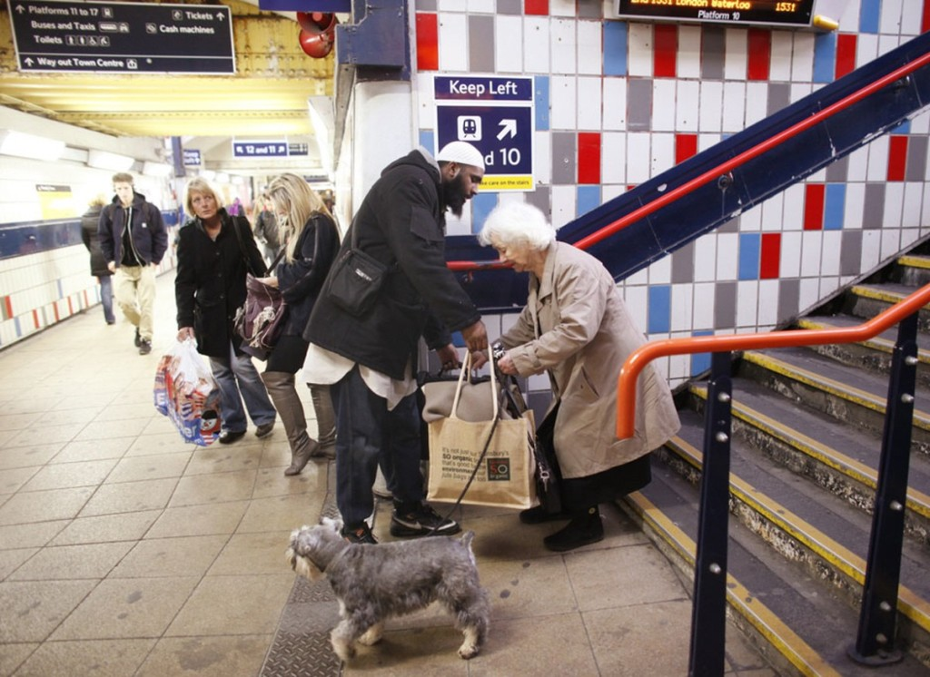 00 Muslim helping old lady in London Underground.