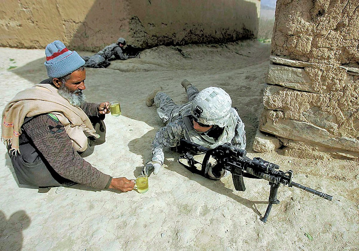 00 Afghanistan. US soldiers and villager. 24.12.12