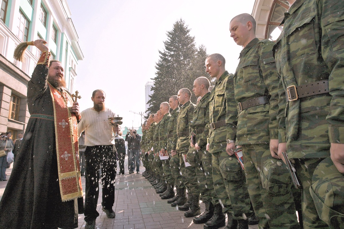 00 russian soldiers being blessed by priest. 27.09.13
