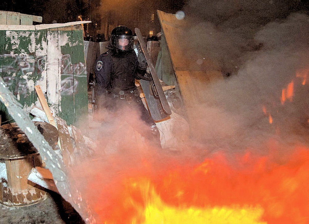 00 Police demolish barricade. Kiev THE UKRAINE. 11.12.13