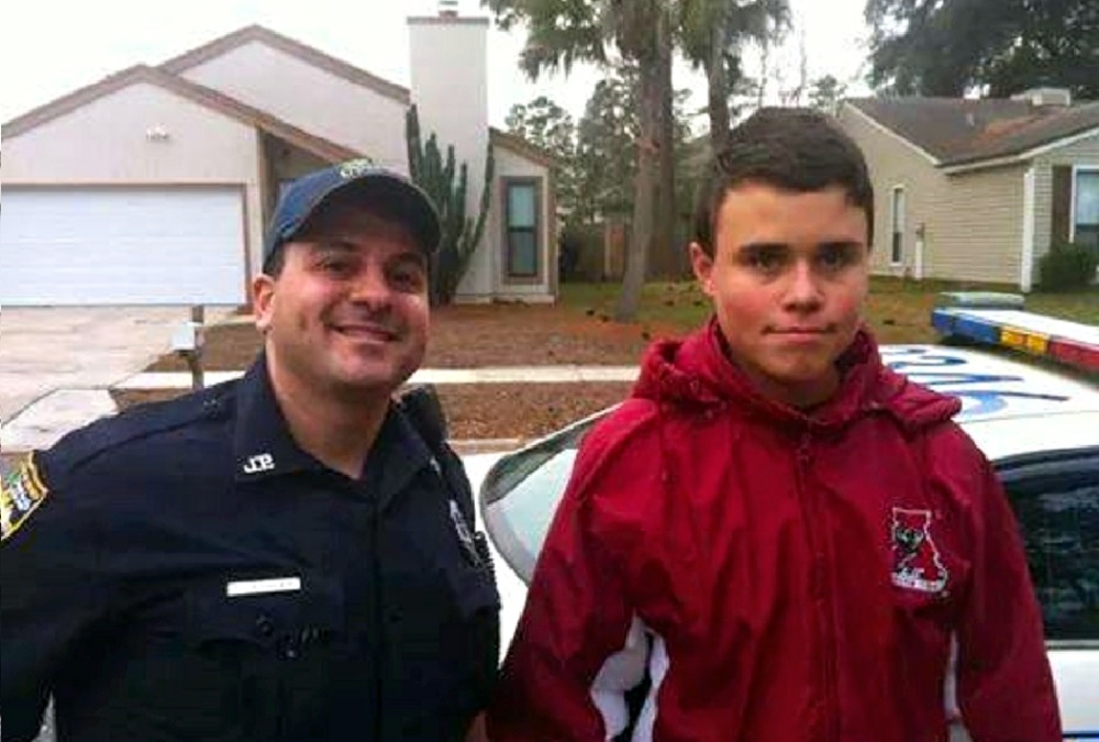 00 jacksonville cop with kid. 10.12.14