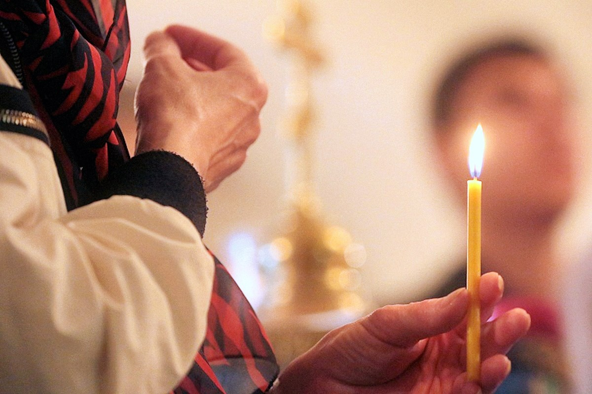 00 orthodox believer with candle 030815