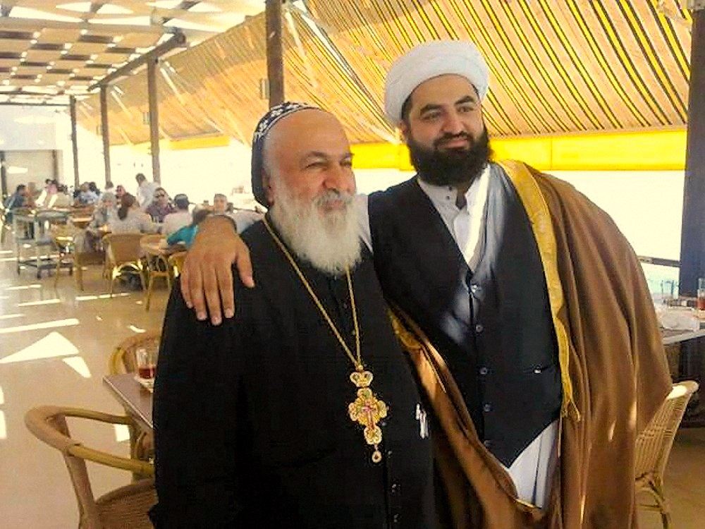 00 syria priest and imam 221115